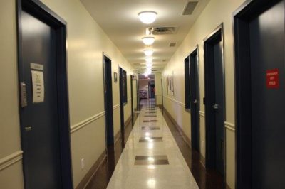Image of hallway in lower level of building towards waiting area and exit